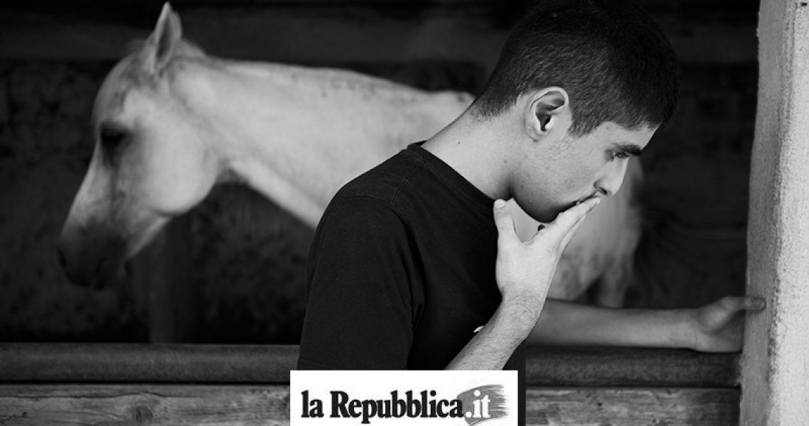 Italy, Succivo (CE), 17/07/2015. Gennaro, one of the two autistic twins, in a riding school during a closing moment. The horse represents a very important animal for the boys and their family. The twins in fact do not speak and the only time that Maurizio, one of the two spoke, said the word